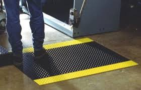 Guy standing on a safety mat